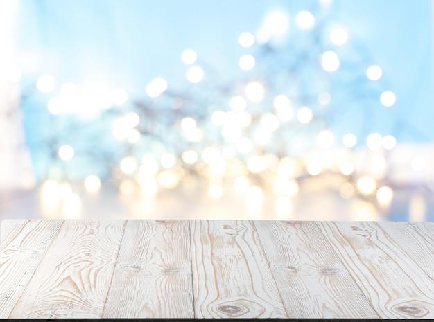 Luci sfocate con old wood desk per la presentazione del prodotto