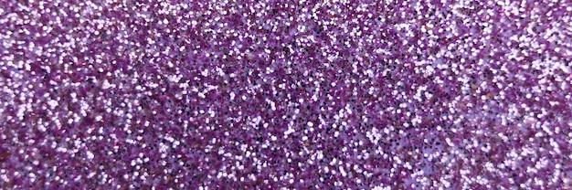 Glitter viola sfocato si chiuda
