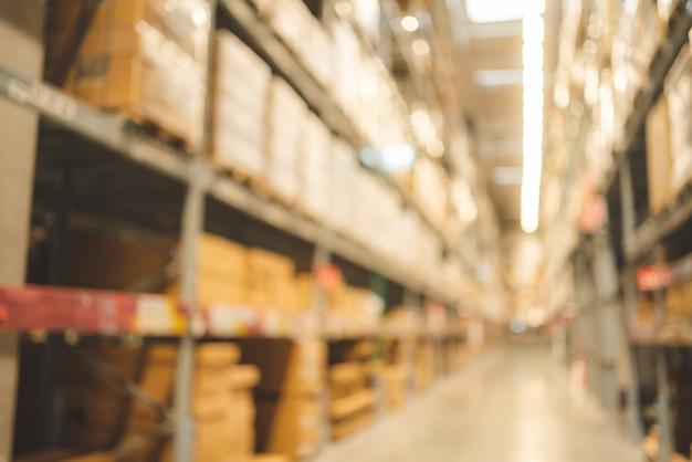 Sfondo sfocato delle scorte di prodotti di inventario del magazzino per lo sfondo logistico, affari globali per una buona importazione ed esportazione, consegna industriale di stoccaggio delle scorte, container di carico della fabbrica logistica