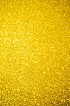 Sfondo sfocato luccicante di paillettes color oro. glitter argento, texture bokeh astratta leggera. disegno di disegno. carta da parati scintillante per natale. tempo di festa.