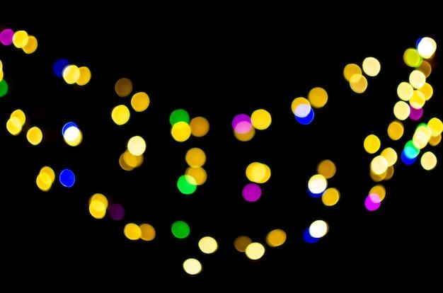 Bokeh di luci colorate su sfondo nero, sovrapposizione ideale per la modifica dello sfondo del livello di sovrapposizione