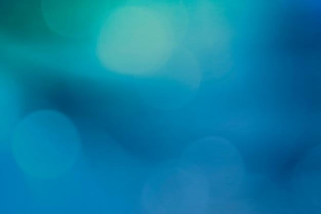 Motivo bokeh su sfondo blu