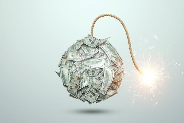 Bomba da banconote in denaro con uno stoppino in fiamme su sfondo bianco. il concetto di finanziario