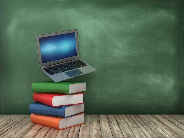 Libri e computer portatile sulla lavagna