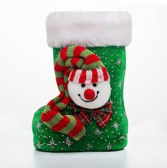 Stivale di babbo natale. stivale invernale per regali e dolci natalizi e san nicola