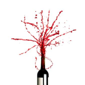Bottiglia con spruzzi di vino rosso