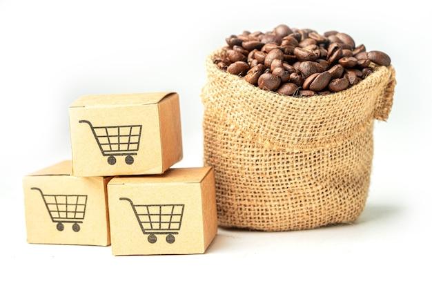 Scatola con il simbolo del logo del carrello sui chicchi di caffè import export shopping online