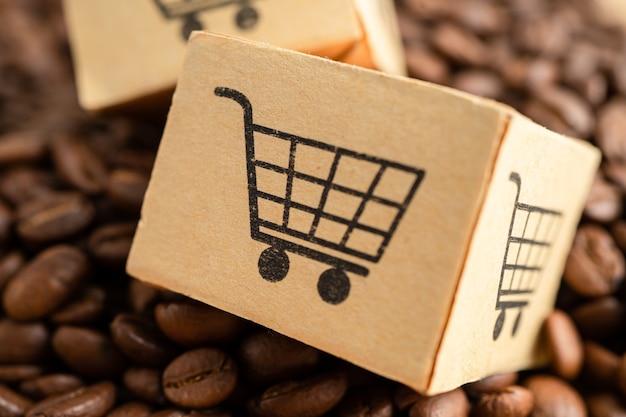 Scatola con simbolo del logo del carrello della spesa sui chicchi di caffè import export