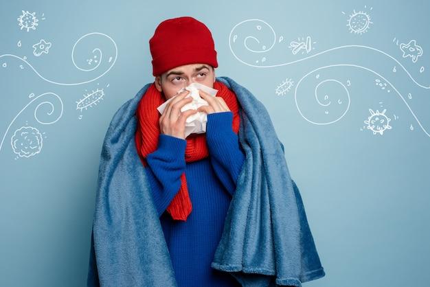 Il ragazzo ha preso un raffreddore e usa le pillole per guarire.