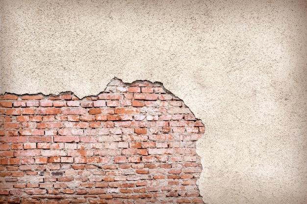 Mattone, muro di cemento esposto all'aria del grunge