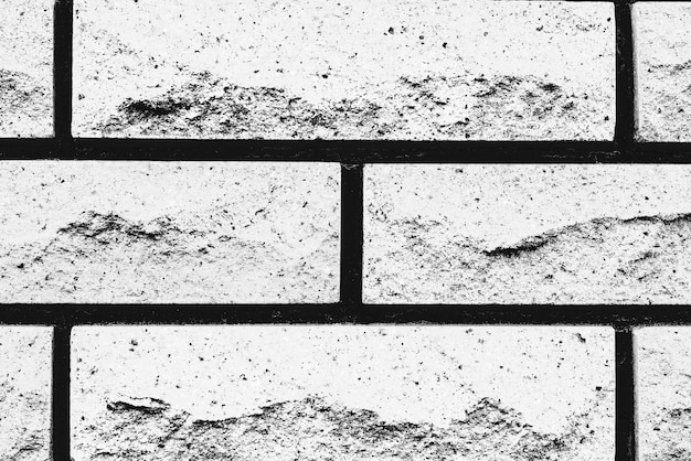 Texture di mattoni con graffi e crepe
