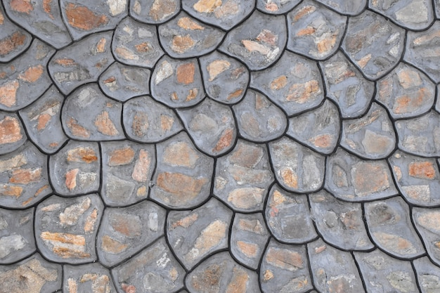 Muro di mattoni di pietra come trama di sfondo.