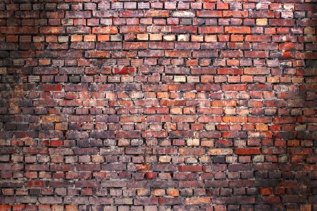 Fondo della via del muro di mattoni per la progettazione, struttura della vecchia muratura