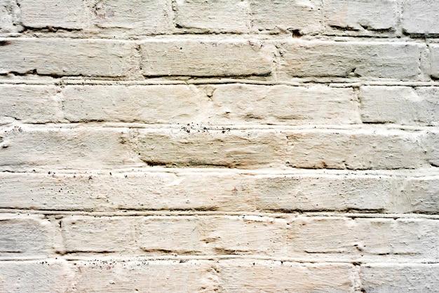 Sfondo texture muro di mattoni. texture di mattoni con graffi e crepe