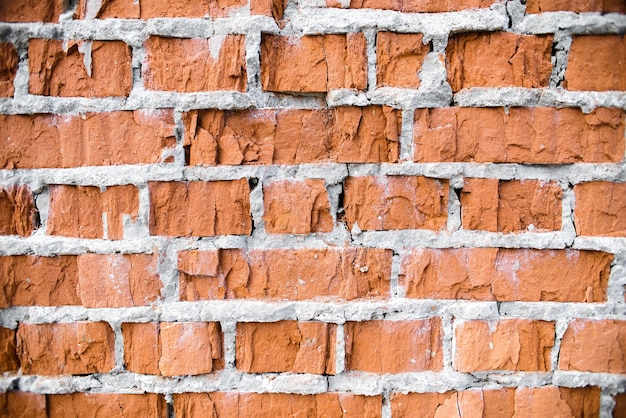 Struttura del muro di mattoni. close-up vecchio muro di mattoni rossi rotti, sfondo. muratura