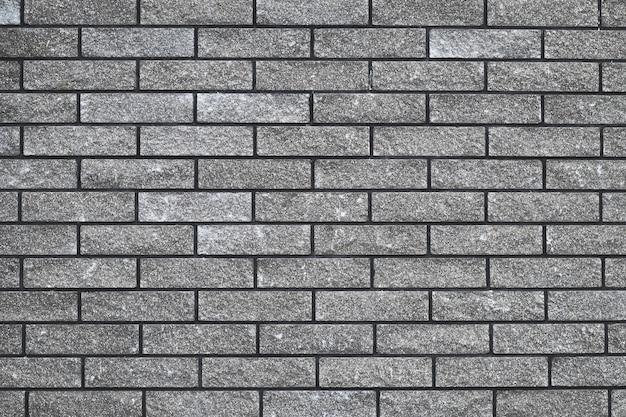 Struttura del muro di mattoni, modello di pietra senza cuciture, muro di mattoni grigio, fondo grigio astratto, progettazione urbana.