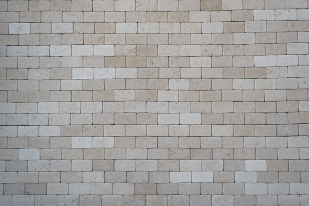 Muratura di mattoni grigi, di grandi dimensioni, all'esterno. fondo di struttura del muro di mattoni, spazio della copia