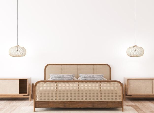 Mockup interno camera da letto luminosa, letto in legno rattan sulla parete bianca vuota