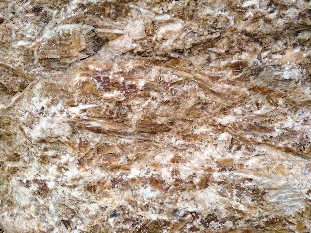 Sfondo di pietra marrone brillante. struttura e fondo di pietra.