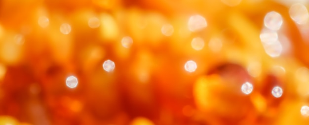 Colori brillanti luce solare ambrata brillante sfondo sfocato la luce del bokeh brilla