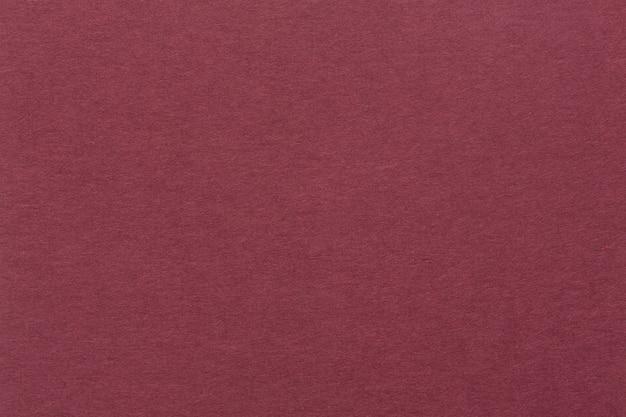 Sfondo rosso brillante da carta fatta a mano organica. immagine di alta qualità.