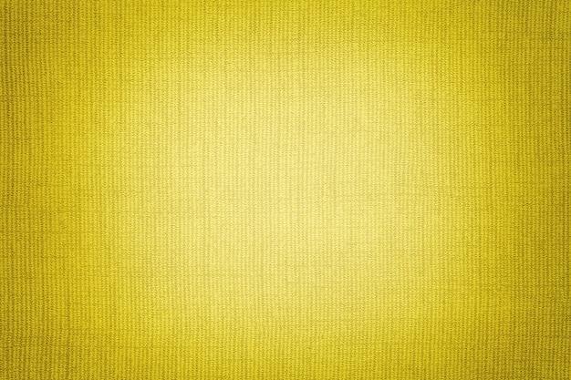 Sfondo giallo brillante da una materia tessile. tessuto con trama naturale. scenografia.