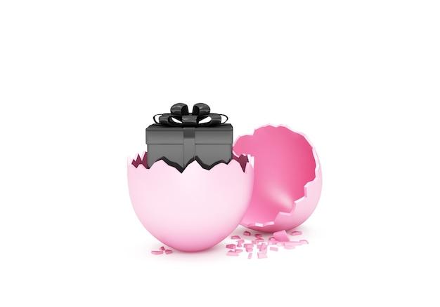 Uovo di pasqua rosa rotto con scatola regalo nera all'interno isolato su priorità bassa bianca