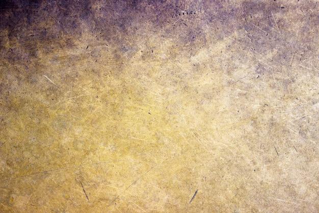 Primo piano del fondo del metallo bronzeo, struttura opaca con una tonalità dorata