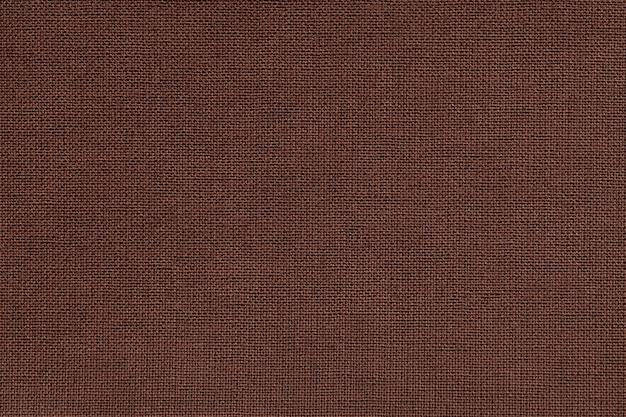 Sfondo marrone da un materiale tessile con pattern di vimini