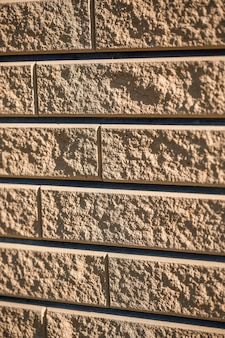 Mattone marrone. struttura del mattone, materiale da costruzione, posa di mattoni lisci durante la riparazione