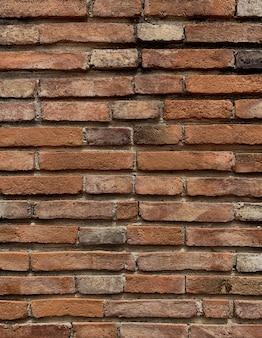 Fine del mattone di brown sul fondo di struttura