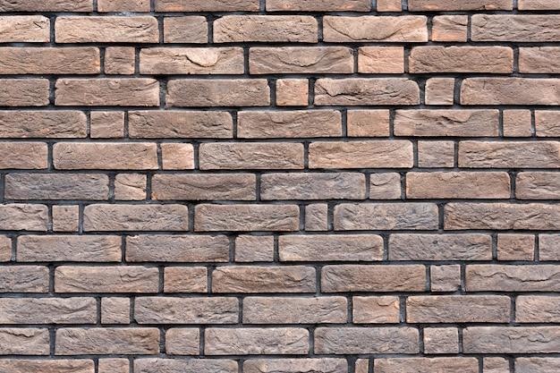 Struttura del muro di mattoni marrone. brickwall grungy. priorità bassa di struttura dei mattoni di stile esterno o loft.