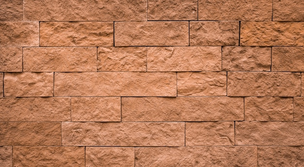 Priorità bassa dell'annata di struttura del muro di mattoni marrone.