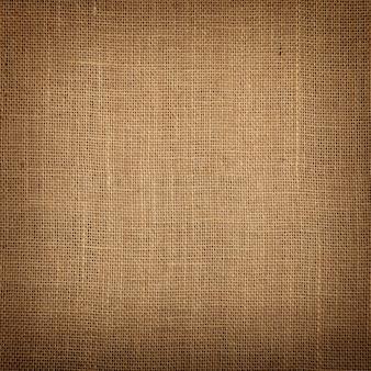 Sfondo di tela di iuta tela marrone con ombra