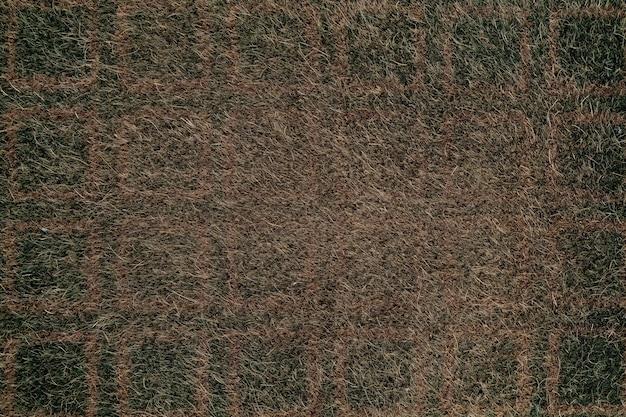 Sfondo tappeto marrone, trama del tessuto