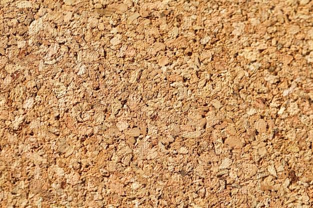 Colore marrone del bordo di sughero. fondo in legno strutturato.