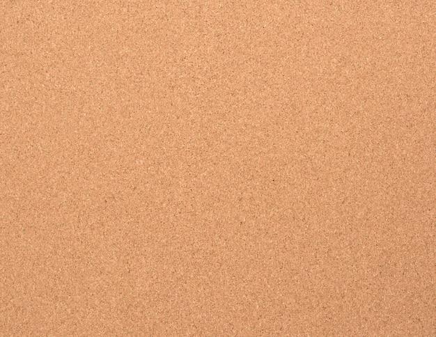 Trama di sughero marrone. lavagna per attaccare la carta a un bottone, full frame