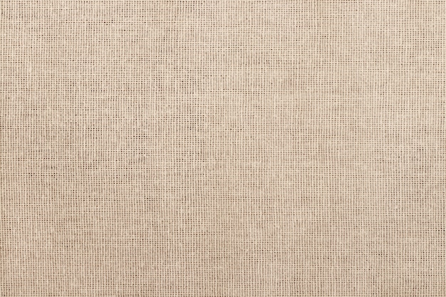 Fondo di struttura del tessuto di cotone marrone, modello senza cuciture del tessuto naturale.