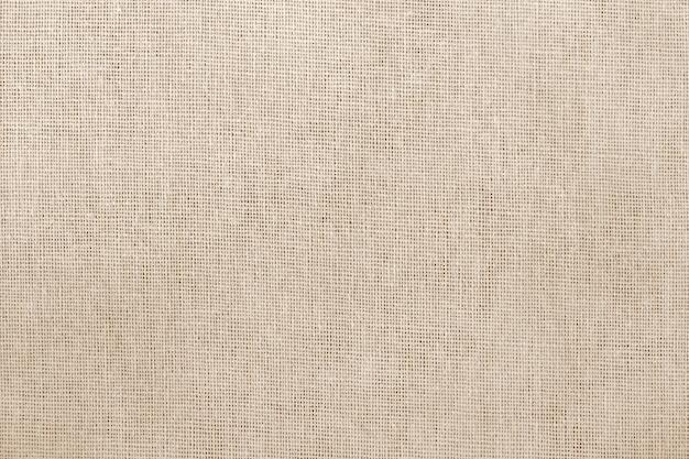 Fondo di struttura del tessuto di cotone marrone con motivo senza cuciture.