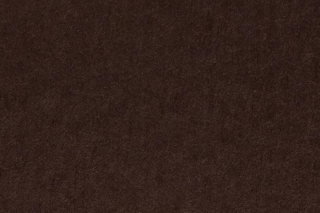 Fondo o struttura della superficie della carta marrone scuro. foto ad alta risoluzione.