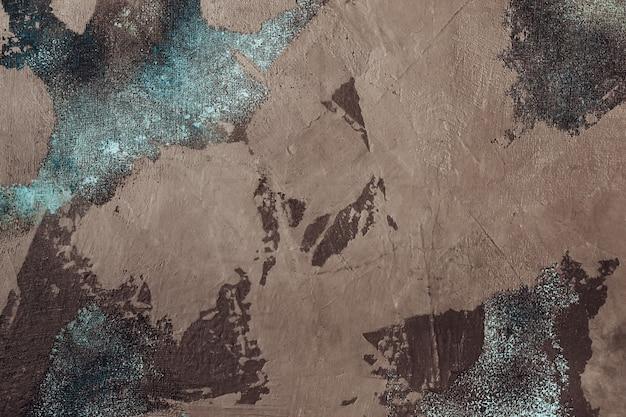 Stucco decorativo marrone con rete in tessuto blu. struttura o fondo atmosferica invecchiata.
