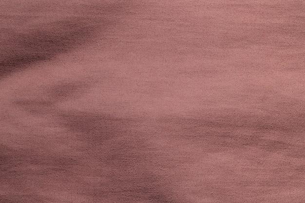 Priorità bassa di struttura del poliestere panno tessuto marrone.