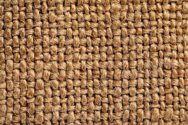 Modello di trama del tessuto di juta della tela da imballaggio della borsa di farina marrone
