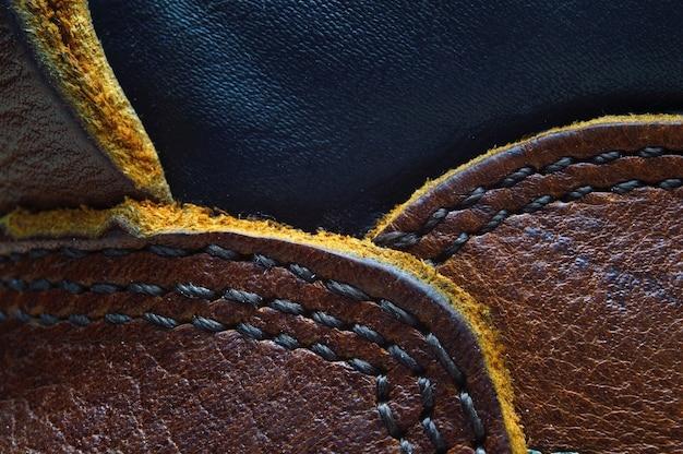 Texture in pelle marrone con una cucitura