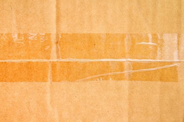 Scatola di carta marrone o foglio di cartone ondulato con texture nastro