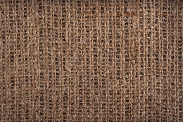 Priorità bassa di struttura di tela di sacco o tela da imballaggio marrone.