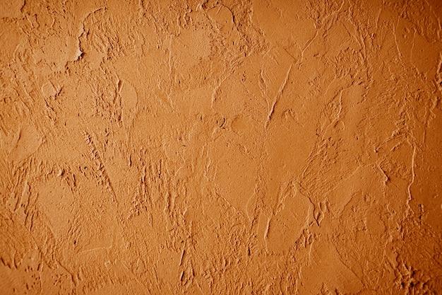 Stucco veneziano decorativo di struttura marrone per gli sfondi.