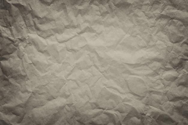 Fondo di struttura di carta vintage marrone per il design nel concetto di superficie di lavoro.