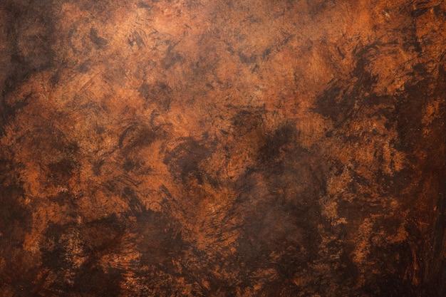 Fondo strutturato della parete stagionata marrone con toni rossastri