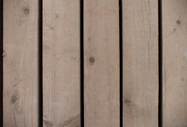 Tavole di legno marrone con fori tra loro texture. spazio per il design